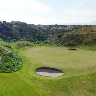 The island golf club cover picture
