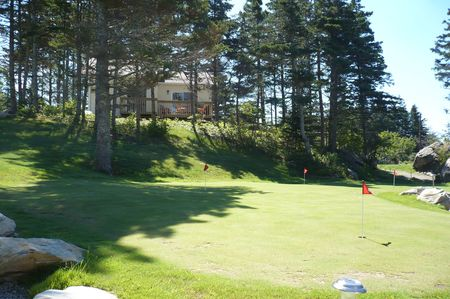 Sluice Point Cottages and Golf Cover Picture