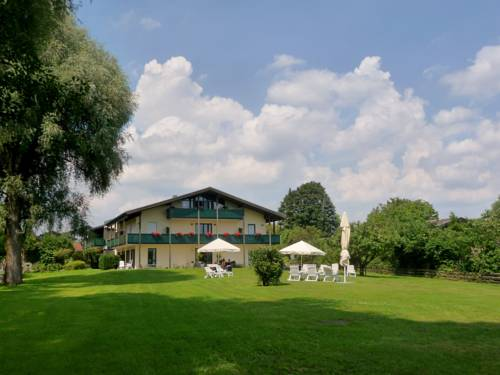 Hotel garni - Chiemsee-Pension-Seebruck Cover Picture