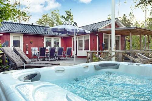 Three-Bedroom Holiday home in Hallstavik Cover Picture