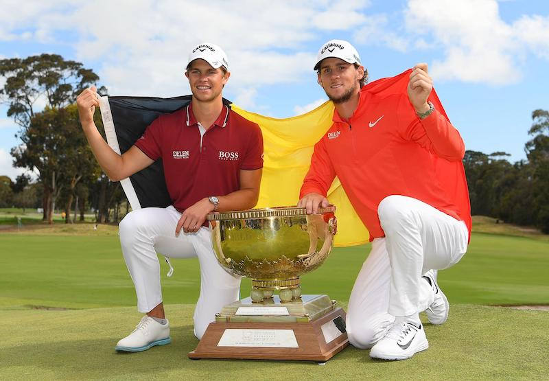 Thomas Pieters & Thomas Detry kneeling next to the World Cup